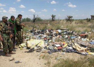 Iraqis Start Exhuming Mass Graves in Tikrit