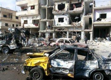 Twin Bomb Blasts Kill Dozens in Syria's Homs