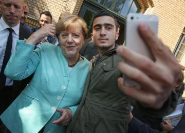 Merkel Opposes Linking Refugees With Terrorists