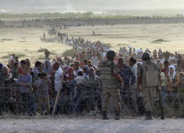 Amnesty: Turkey Deports Refugees to Warzones