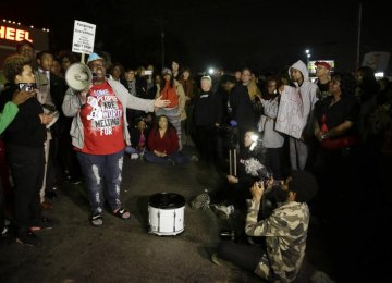 Ferguson Protesters Urge Calm After Two Policemen Injured