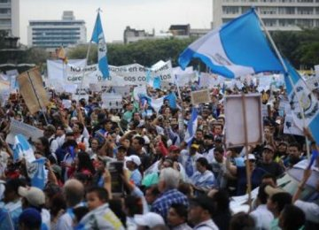 Guatemalans March Against President
