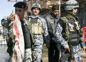 Twin Blasts Kill Nearly 60 in Iraq