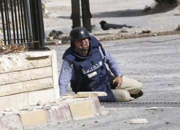 IFJ: 118 Journalists Killed in 2014