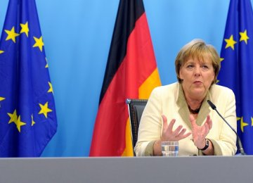 Merkel Defends Refugee  Policy Amid Discontent