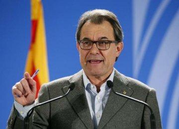 Spain Files Suit AgainstMas