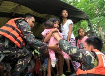 Thousands Flee as Typhoon Threatens Philippines, Taiwan