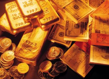 Bullion Tumbles  on Stronger Dollar