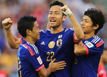 Japan, Iraq Win in Group D