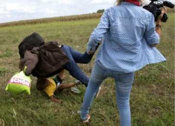 Hungarian TV Journalist Filmed  Kicking Refugee Kids