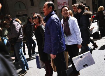 Chinese Tourists Keeping US Cities Flushed With Cash