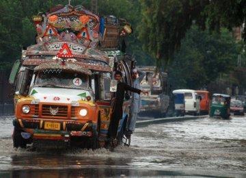 Quake, Floods Kill Dozens in Pakistan
