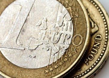 Euro Falls, Pound Rallies