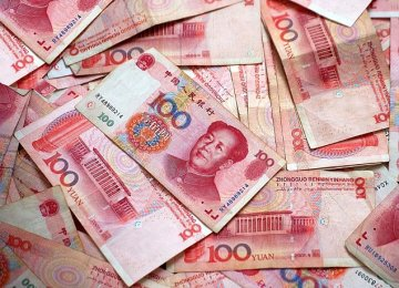 Yuan Sinks as PBOC Surprises With Weaker Fixing