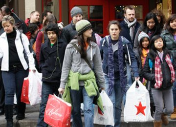American Consumers Thrive, Business Outlays Struggle