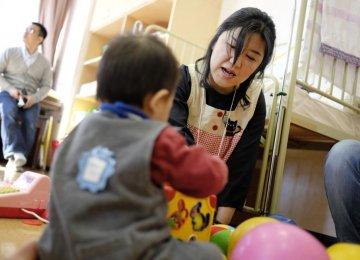 Economic Troubles Hit  Japan's Single-Parent Families