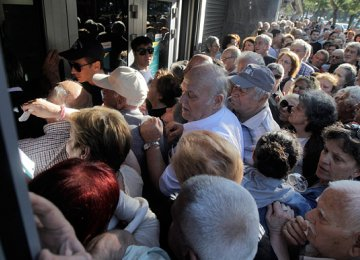 Greece Banks Reopen, Taxes Hiked