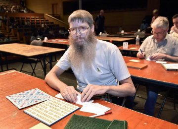 French Scrabble Champ Knows no French