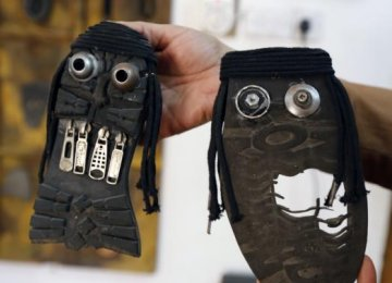 Iraqi Artist Shows 'Ugly Faces' of IS With Old Shoes