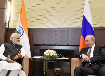 India's Prime Minister Narendra Modi (L) and Russian President Vladimir Putin speaking during their meeting in Sochi. (Photo: AFP)