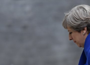 Britain's Prime Minister and leader of the Conservative Party Theresa May returns to 10 Downing Street in central London on June 9,   after making a statement following the results of a snap general election.