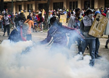Opposition demonstrators clash with riot police during an anti-government protest in Caracas on July 21.