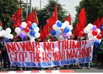 Protestors march toward the US embassy to protest against the visit by US President Donald Trump before the start of the 31st  ASEAN Summit in Manila on Nov. 12.