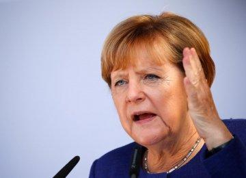 Merkel Vows to Restrict Trade With Turkey Over Arrests
