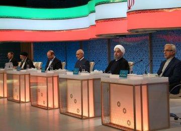 Presidential hopefuls attend a televised debate in Tehran on May 5.