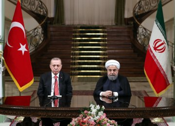 President Hassan Rouhani (R) and his Turkish counterpart, Recep Tayyip Erdogan, attend a press conference in Tehran on Oct. 4.