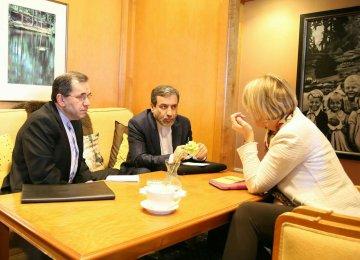 Iranian deputy foreign ministers, Majid Takht-Ravanchi (L) and Abbas Araqchi (C) meet EU political director, Helga Schmid, in Vienna on Jan. 10.
