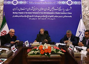 Majlis Speaker Ali Larijani meets ambassadors of Muslim countries in Tehran on June 19.