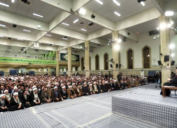 Ayatollah Seyyed Ali Khamenei receives a large group of people from the holy city of Qom in Tehran on Sunday.