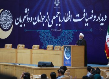 President Hassan Rouhani meets university students in Tehran on June 12.