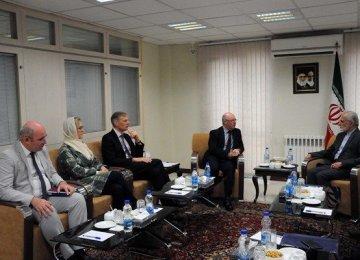 Kamal Kharrazi (R) talks with UK Junior Foreign Minister Alistair Burt in Tehran on Sunday.