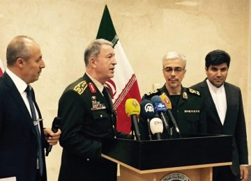 Iranian and Turkish military chiefs attend a press conference in Tehran on Oct. 2.