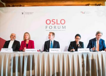 Foreign Minister Mohammad Javad Zarif (L) at the opening ceremony of the Oslo Forum, June 13.
