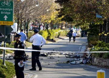 Bicycles and debris lay on a bike path after a motorist drove onto the path near the World Trade Center memorial killing eight people on November 1.