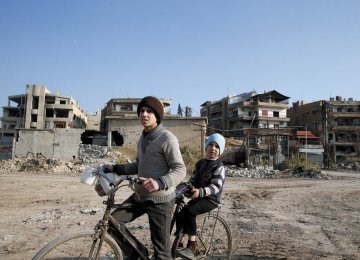 Syrian boys in the rebel-held Eastern Ghouta, on the outskirts of Damascus in January.