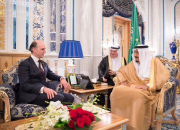 Conservative MP Leo Docherty (L) has been reported to the UK parliamentary standards watchdog  over his meeting with Saudi King Salman.