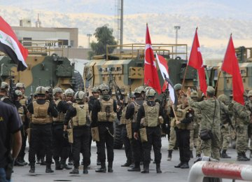 Iraqi and Turkish troops gathered at the Habur/Ibrahim Khalil border crossing between Iraq and Turkey for a ceremony celebrating  the return of control of the crossing to the Iraqi central government on Oct. 31.