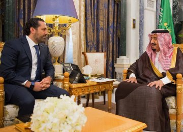 Saudi King Salman (R) meets with outgoing Lebanese Prime Minister Saad Hariri in Riyadh, Saudi Arabia, Nov. 6.