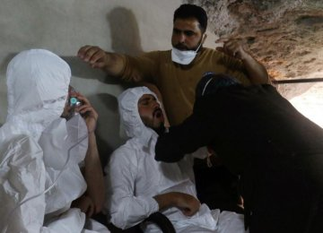 A man breathes through an oxygen mask as another one receives treatment, after what rescue workers described as a gas attack in the town of Khan Sheikhoun in rebel-held Idlib, Syria April 4.