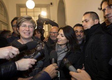 Italy's anti-establishment 5-Star Movement member Giuliana Di Pillo (L) speaks with journalists next to Rome's mayor Virginia Raggi in Ostia, Italy, Nov. 19.