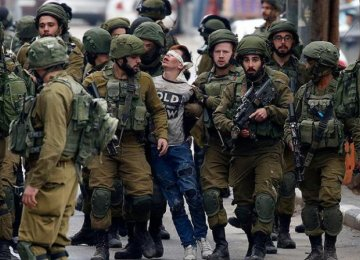 Blindfolded Fawzi al-Junaidi surrounded  by more than 20 Israeli forces