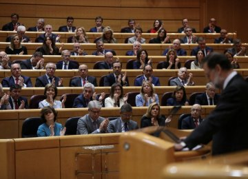 People's Party (PP) senators and members of government applaud as Spain's Prime Minister Mariano Rajoy pauses his speech during a debate at the upper house Senate in Madrid, Spain, October 27.