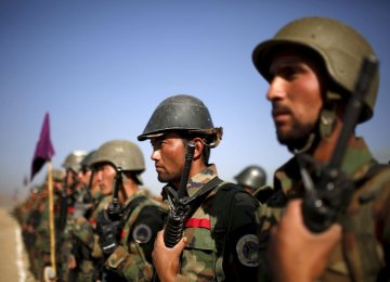 Afghan National Army officers stand at attention during a training exercise at the Kabul Military Training Centre (File Photo).