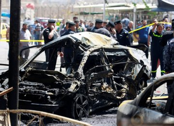 The scene of the car bomb attack near a government office in Karkh District in Baghdad, Iraq, on May 30