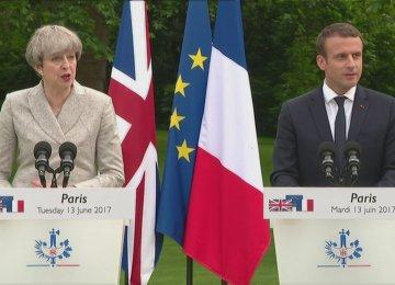 Theresa May and Emmanuel Macron meet at the Elysee Palace in Paris on June 13.