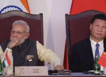 Indian Prime Minister Narendra Modi (L) will visit his Chinese counterpart President Xi Jinping in September  for a summit of BRICS leaders.